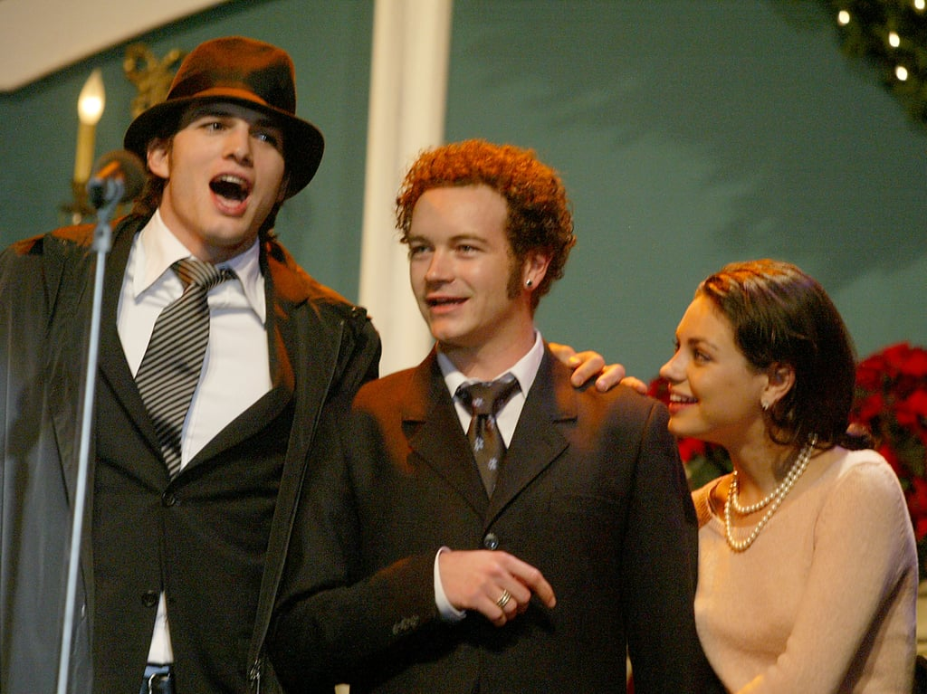 Mila gave Ashton a sweet glance during a performance with Danny Masterson at a Christmas fundraiser in LA in December 2003. Source: Getty / Frazer Harrison