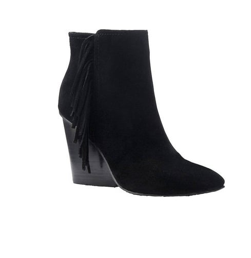 The beginning of Fall means it's time to start thinking about booties! This Isola pair ($139) is a classic style, but with just a bit of fringe for something extra. — LM