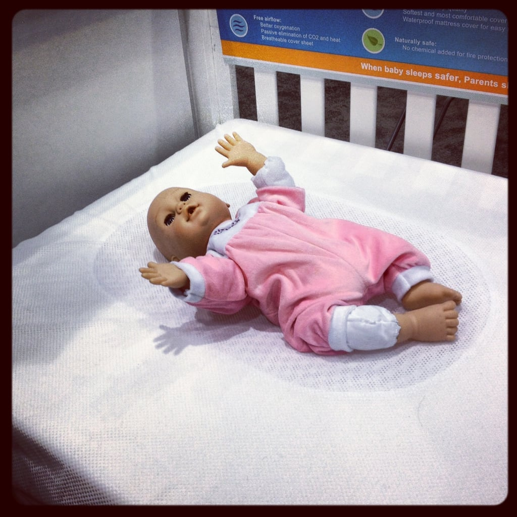 Ubimed's Lifenest is a newborn mattress topper with a hammock in its middle to lessen the pressure on a baby's head, and thus help prevent flat heads. Its mesh sheet also helps keep air flowing, so if baby rolls over by mistake, she can still breathe.