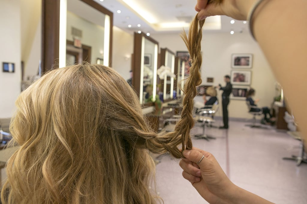 Now you have to drape the braid to create a woven shape in the back of your head. Start off by pulling the dual-braid up and then bend the braid about four inches from your head.