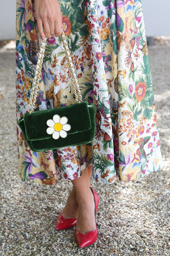 A daisy-adorned clutch drove the floral theme home.