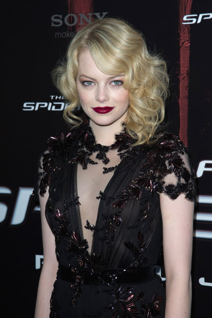This is one of our favorite ever red carpet looks from Emma Stone. Create the curls with an iron, and fluff them up slightly to give a slight halo effect. Pull all but one lock of hair back on one side, but leave more hanging loose on the wider side of your parting.
