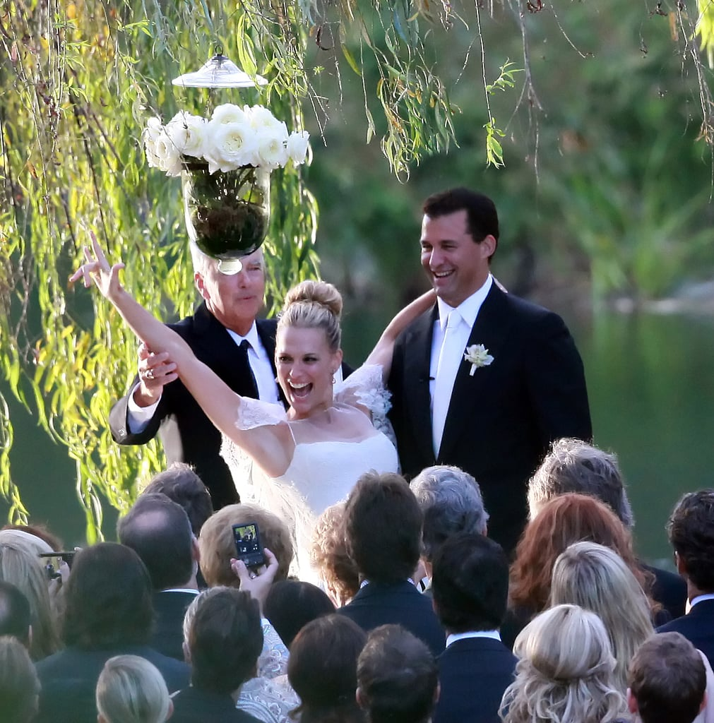"""Molly Sims chose a mermaid-style Marchesa gown with lace sleeves when she said """"I do"""" to Scott Stuber in Napa during September 2011."""