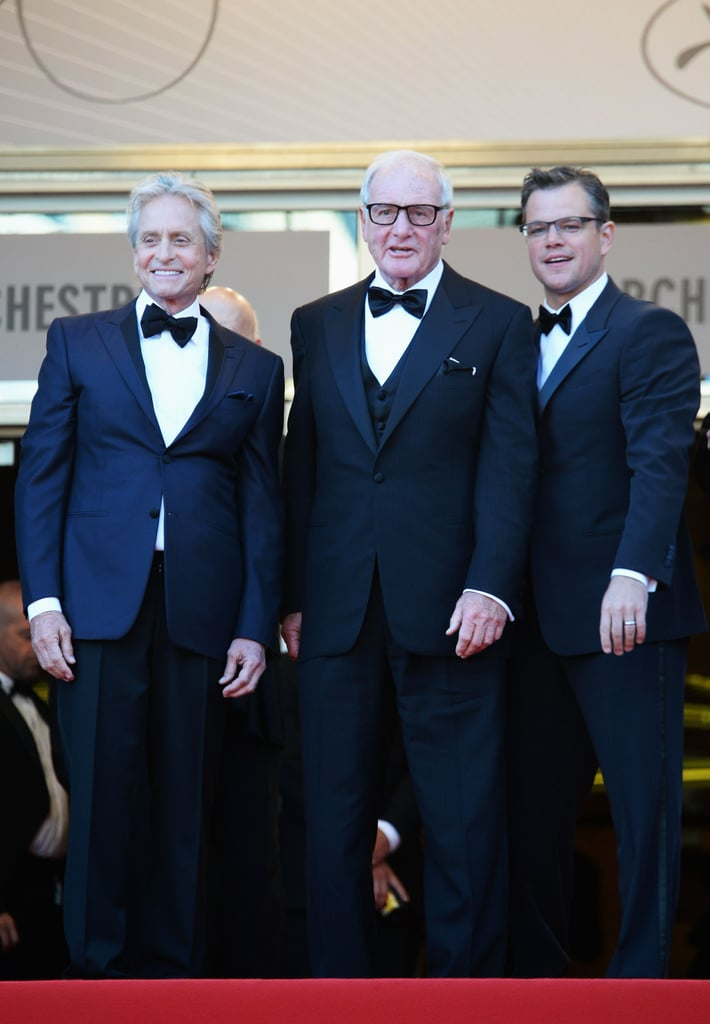 Matt Damon and Michael Douglas stood on the steps of the Palais in Cannes with producer Jerry Weintraub.