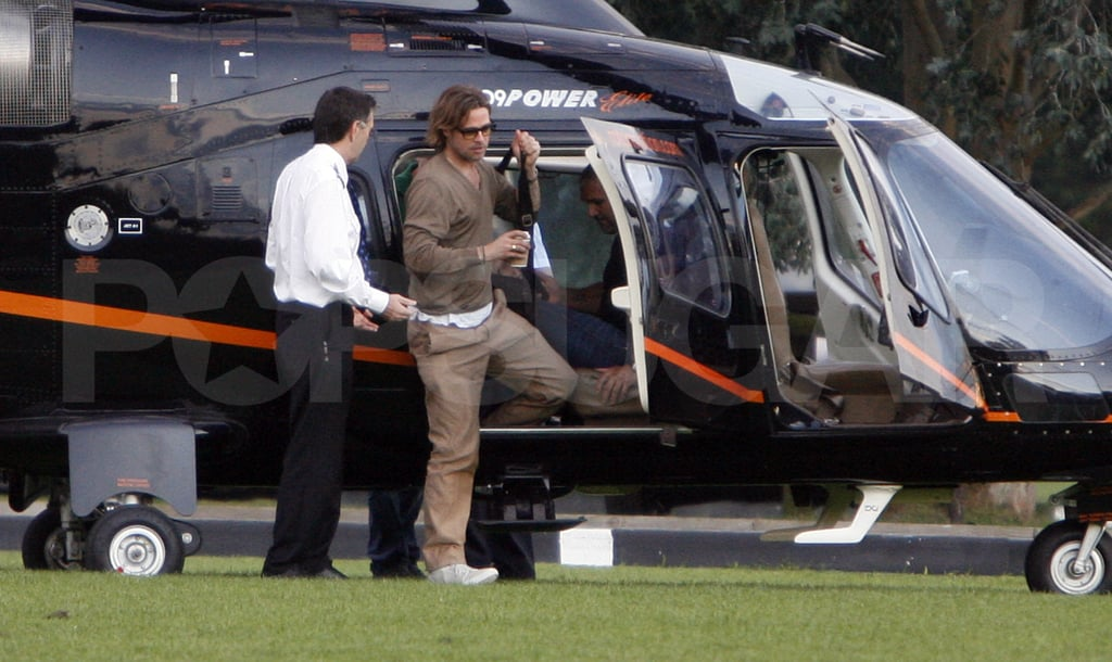 Brad Pitt lands in London.