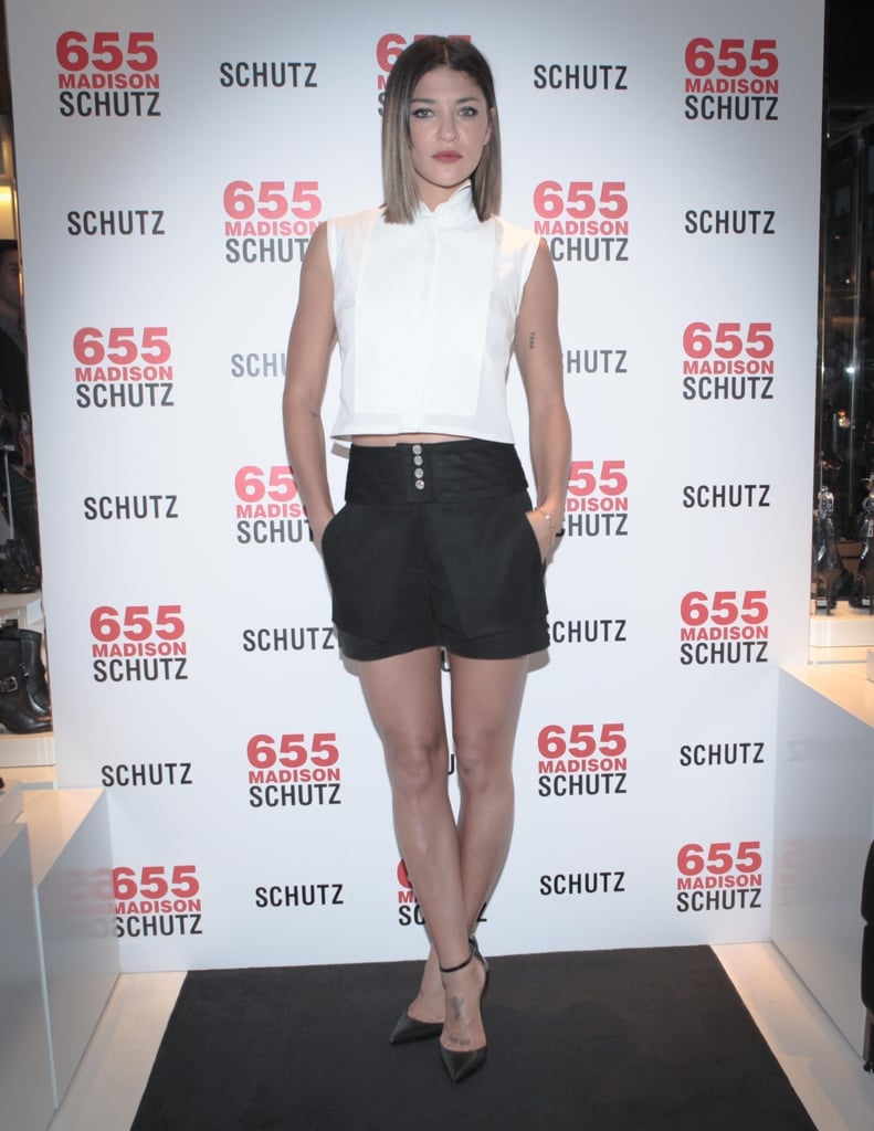 Jessica Szohr paired a white crop top with black shorts at the Leigh Lezark X Schutz one-year anniversary party in NYC.