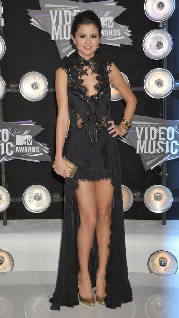 Selena took a sexy Gothic turn at the 2011 MTV VMAs — she sported a lacy black Julien Macdonald dress with a high-low hem.