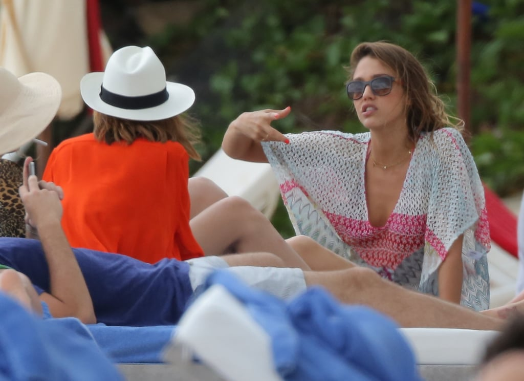 Jessica Alba chatted with friends in St. Barts on Friday.