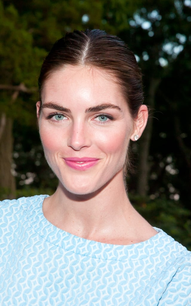 Hilary Rhoda looked simple and sweet with a slicked-back ponytail with a middle part. She complemented the look with minimal eye makeup and a pink flush on her lips and cheeks.