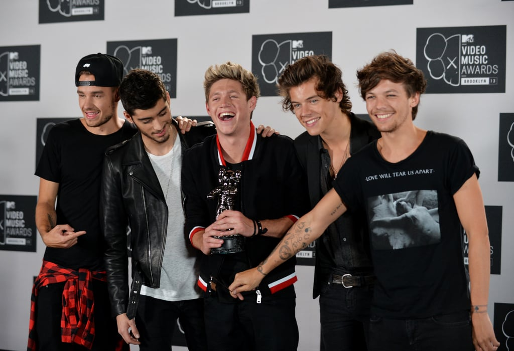 The One Direction boys posed with their award in the press room.