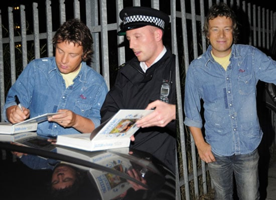 Saucy Jamie Oliver Smiles and Signs