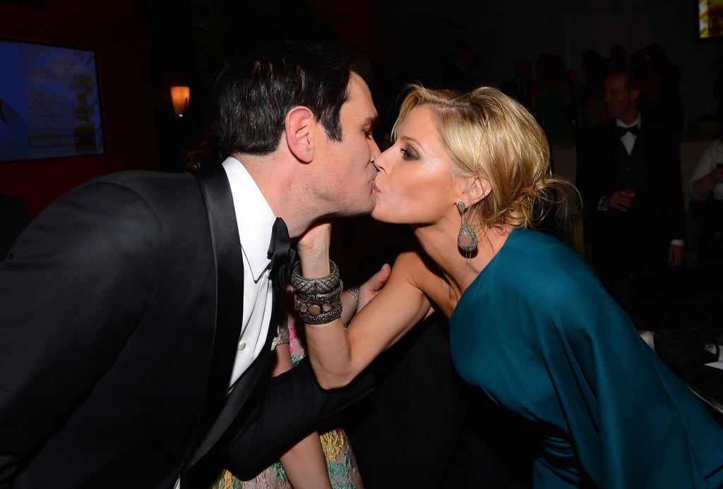 Modern Family costars Ty Burrell and Julie Bowen kissed at Fox's Golden Globes afterparty.