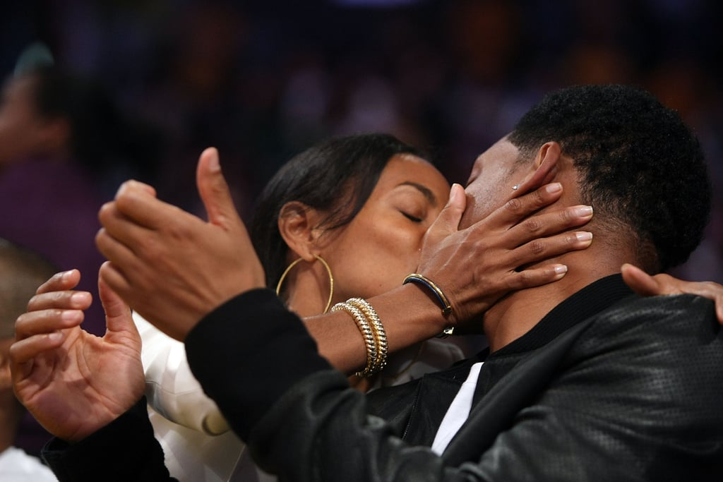 Jada Pinkett Smith was caught putting a wet one on Will Smith at a Lakers game.