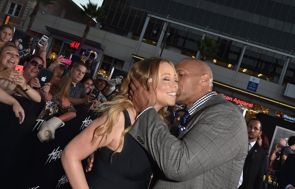"Mariah Carey got a kiss from Dwayne ""The Rock"" Johnson at the Hercules premiere in LA on Wednesday."