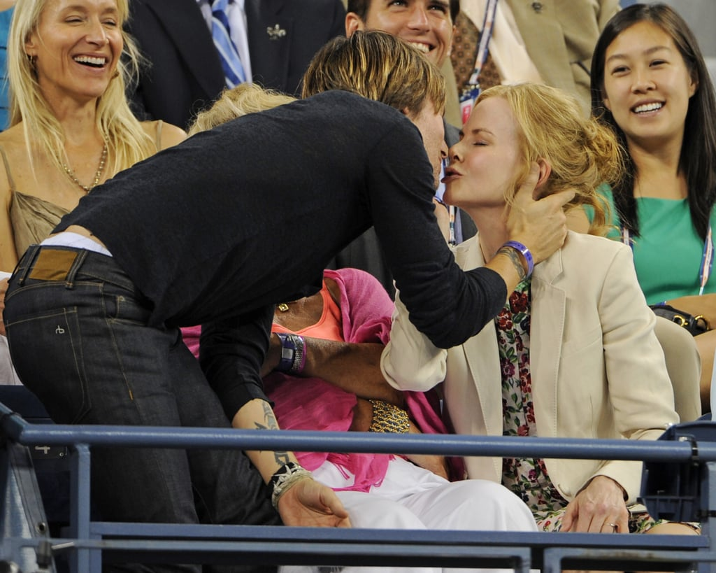 Nicole Kidman and Keith Urban snuck a kiss while watching the US Open in NYC in August 2012.
