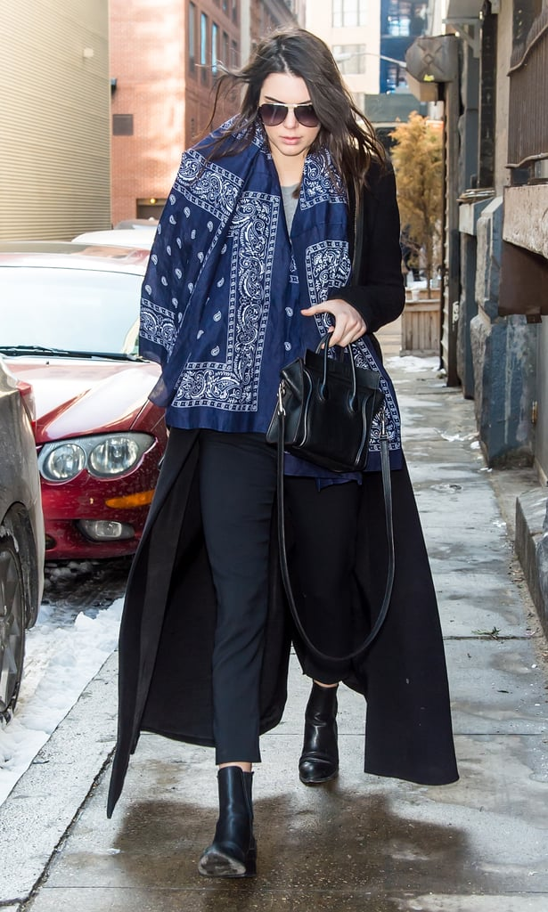 Kendall Jenner kept her dark outfit from being bland with a giant printed scarf.