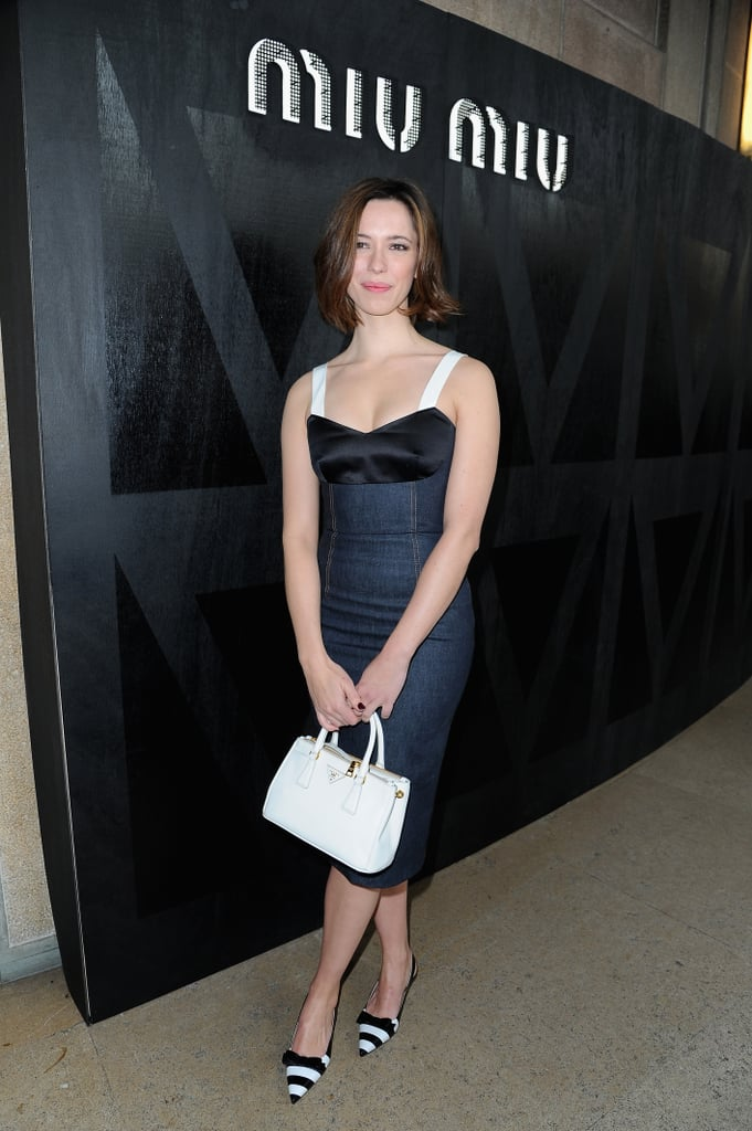 Rebecca Hall donned a bustier-style denim dress with striped pumps and a white Prada bag at Miu Miu's show.