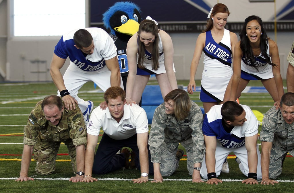 Prince Harry made a human pyramid with Air Force cheerleaders.