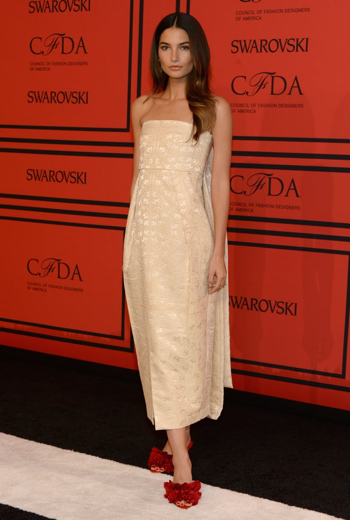 Lily Aldridge's strapless The Row dress was given a major jolt thanks to her red ruffled mules.