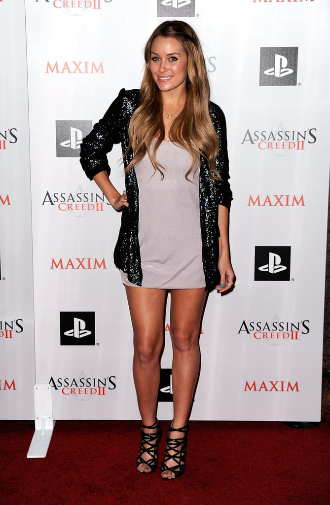 At the launch of Assassin's Creed II LC wears a sequinned blazer, basic minidress and Jimmy Choo heels.
