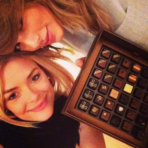 Jaime King and Taylor Swift cozied up to a delectable box of chocolates for a girls' night in. Source: Instagram user jaime_king