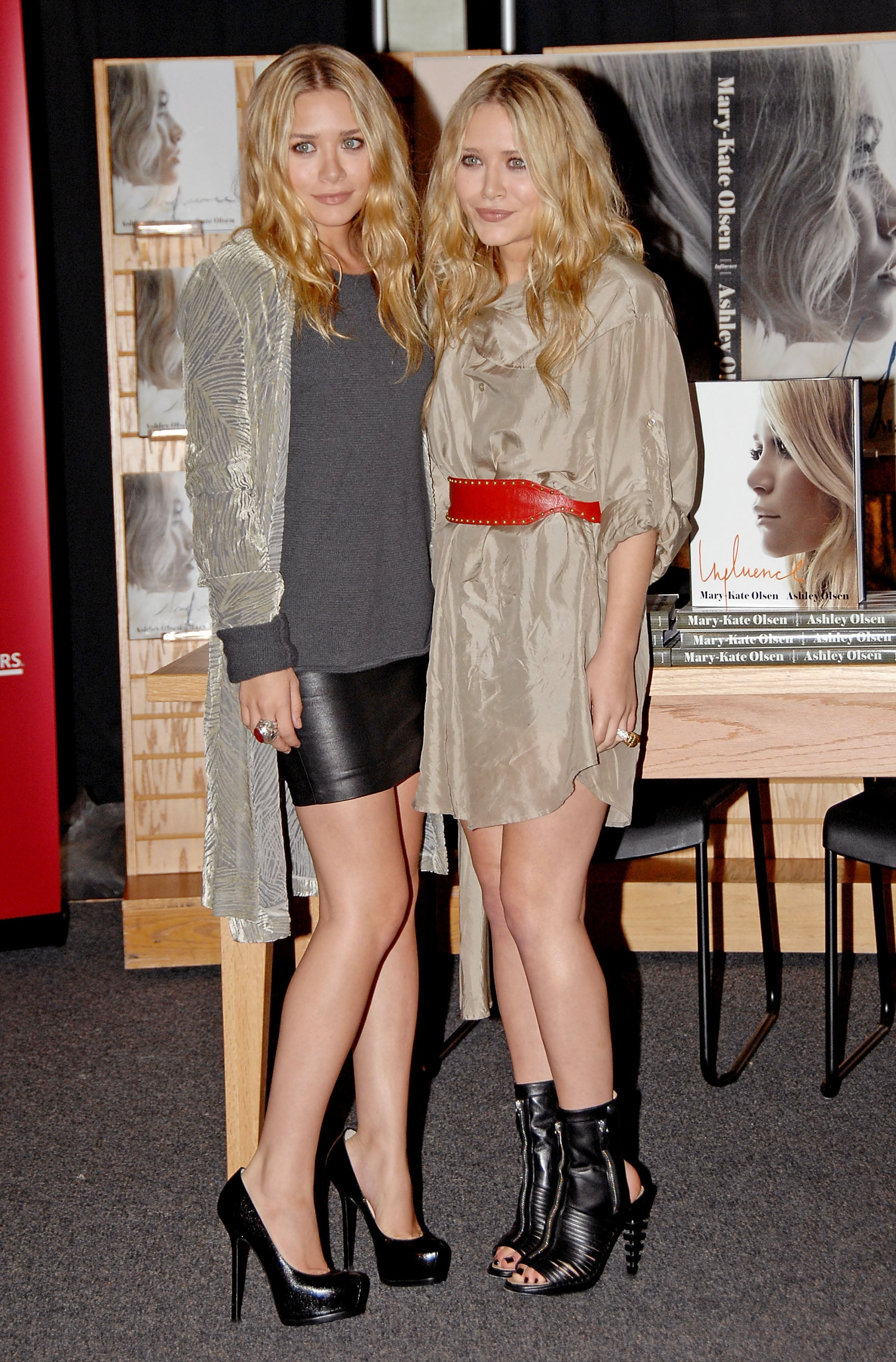 Twinning combo: During a 2008 LA book signing for Influence, the twins turned up the edge with pops of leather.   Ashley wore a velour coat with a charcoal sweater, leather miniskirt, and classic pumps. Mary-Kate paired her shirtdress with a red leather belt and zippered leather peep-toe booties.