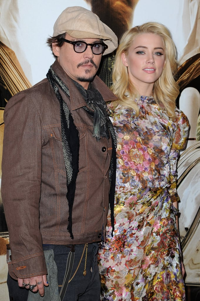 Johnny and Amber stepped out in Paris for this morning's photocall.