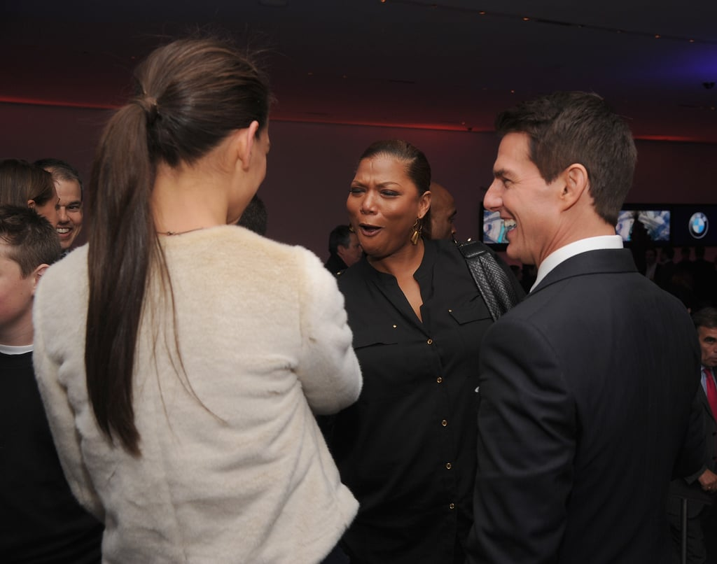 Queen Latifah and Katie Holmes got a big smile out of Tom Cruise.