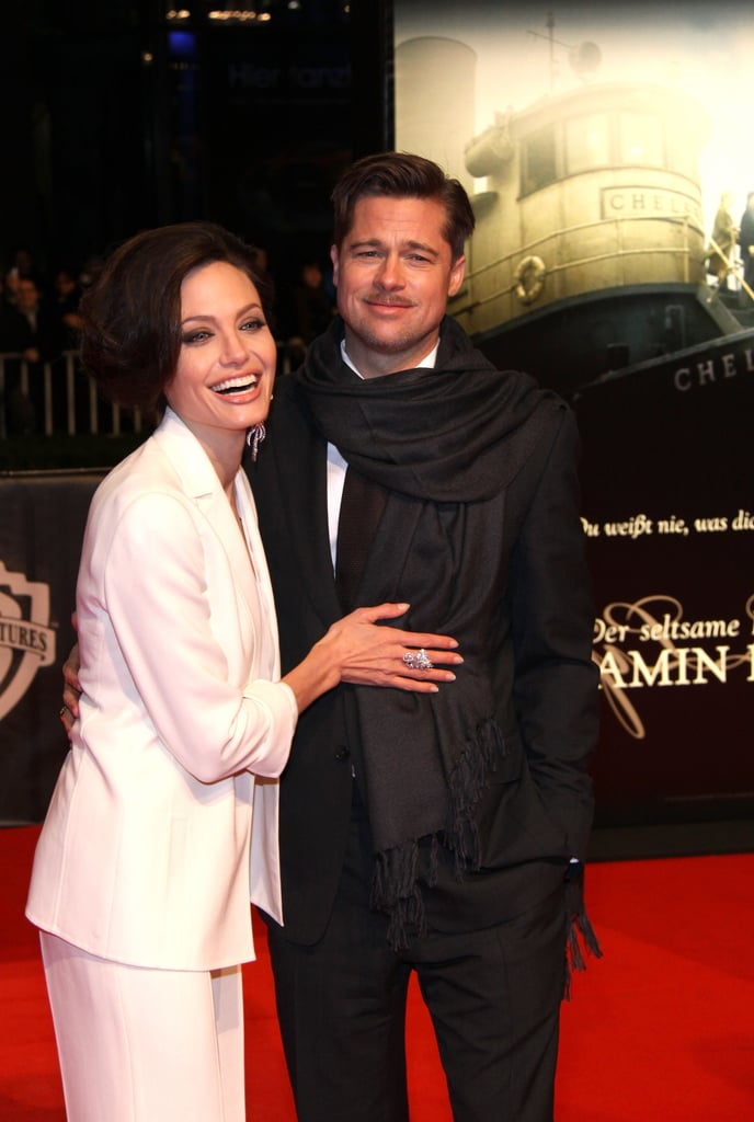 Angelina Jolie rested her hand on Brad Pitt's chest while posing for photos at his January 2009 Berlin premiere of The Curious Case of Benjamin Button.