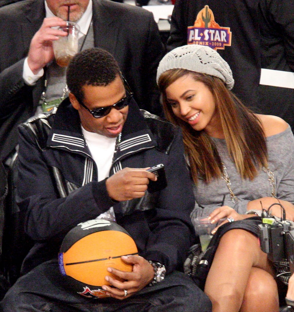 Beyoncé checked out a message on Jay-Z's phone at the All-Star Game in February 2009.