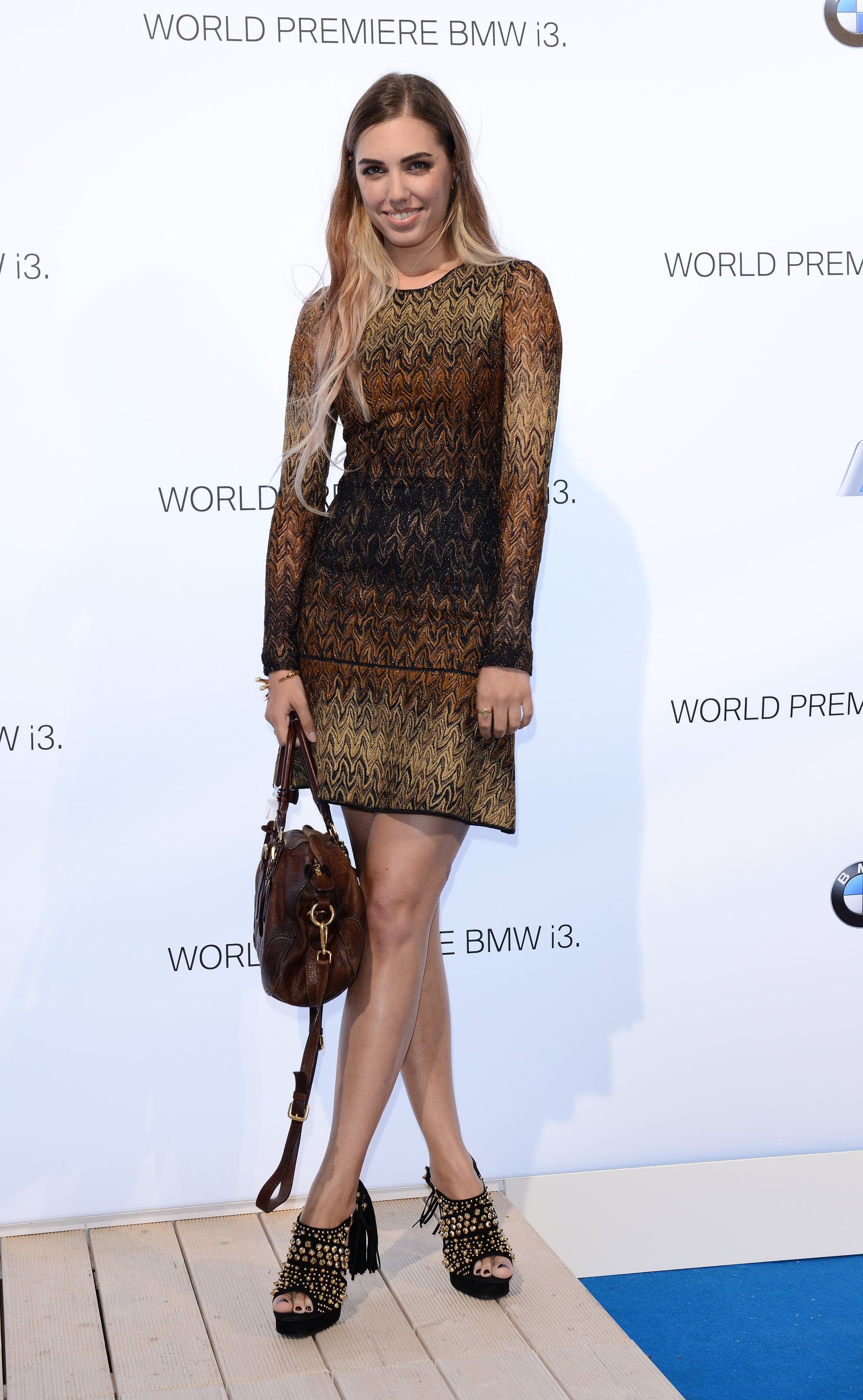 Amber Le Bon sparkled in a glittering sheath and embellished platforms at the BMW unveiling of the i3.
