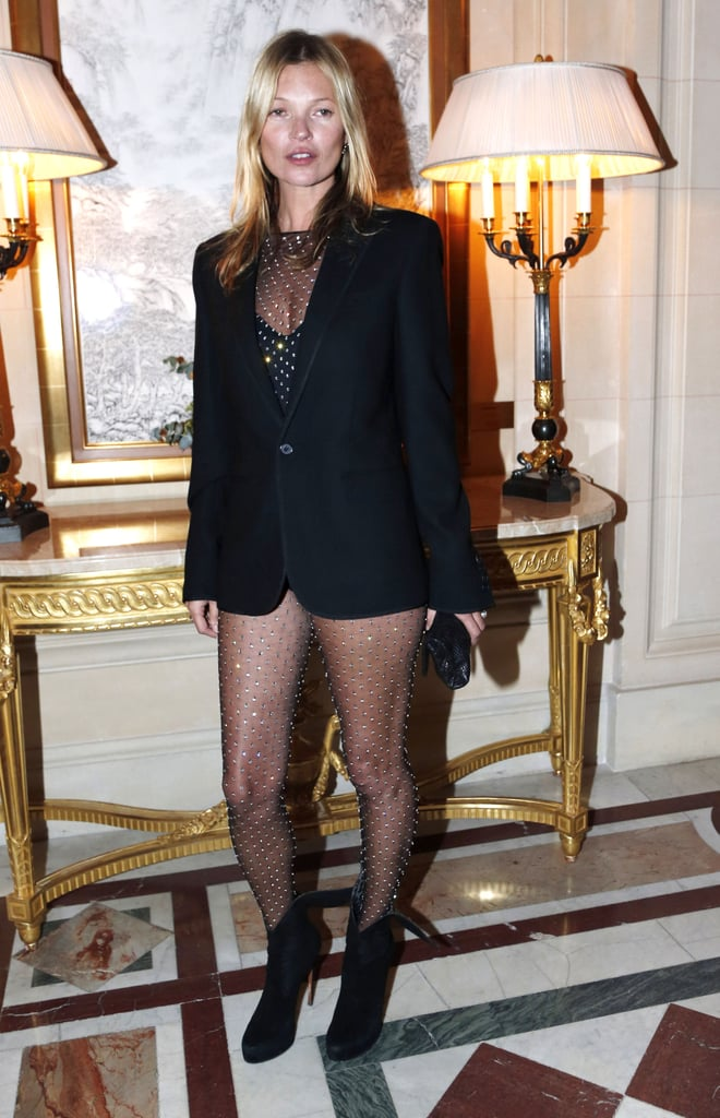 Kate Moss posed in her sexy bodysuit at the CR Fashion Book party during Paris Fashion Week.