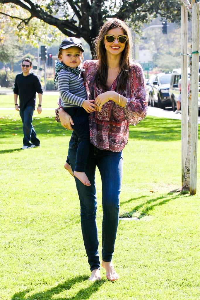 Miranda Kerr toted her son Flynn — who suddenly seems so big! — through a sunny park in LA on February 17.