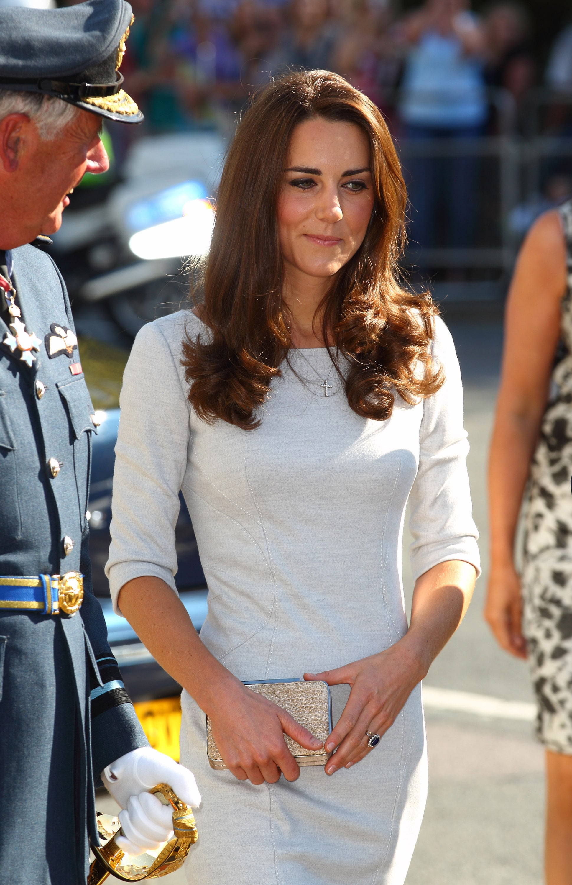 Kate Middleton carried a small clutch.