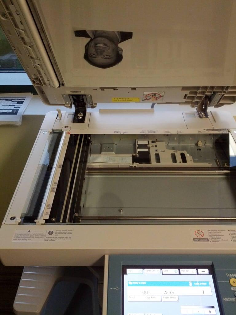 Nicolas Cage-ify the photocopy machine.