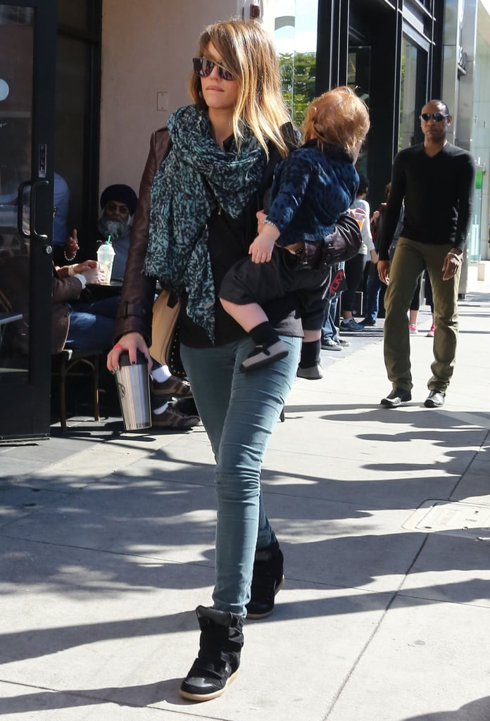 Jessica Alba took a stroll in LA in colored denim, a matching printed scarf, and cool Isabel Marant sneakers.