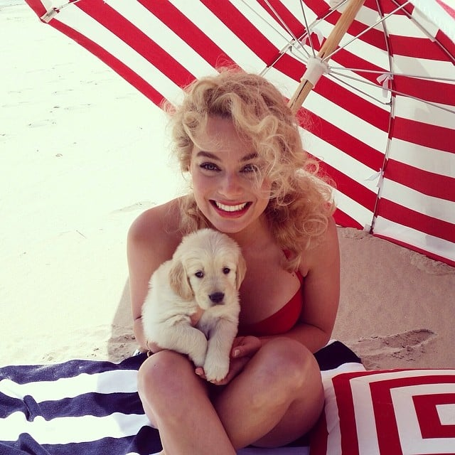 Margot Robbie thought about stealing a puppy in this throwback photo. Source: Instagram user margotrobbie