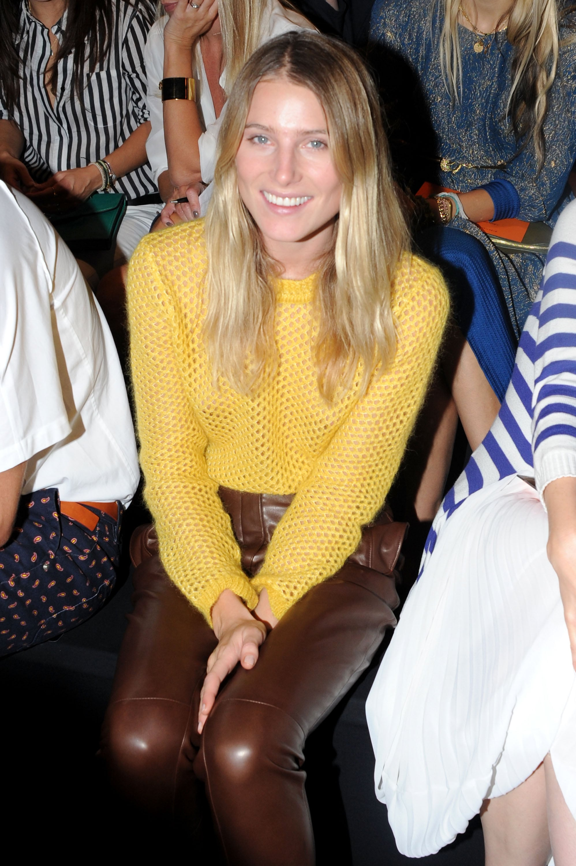 Dree Hemingway styled up a gorgeous Fall look, in a yellow knit and contrasting leather pants, front row at Ermanno Scervino at Milan Fashion Week.
