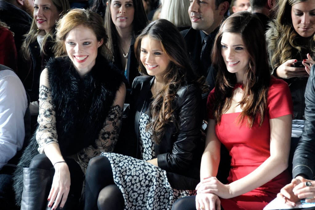 Nina Dobrev flashed a smile with Ashley Greene and Coco Rocha from their front-row seats at DKNY.