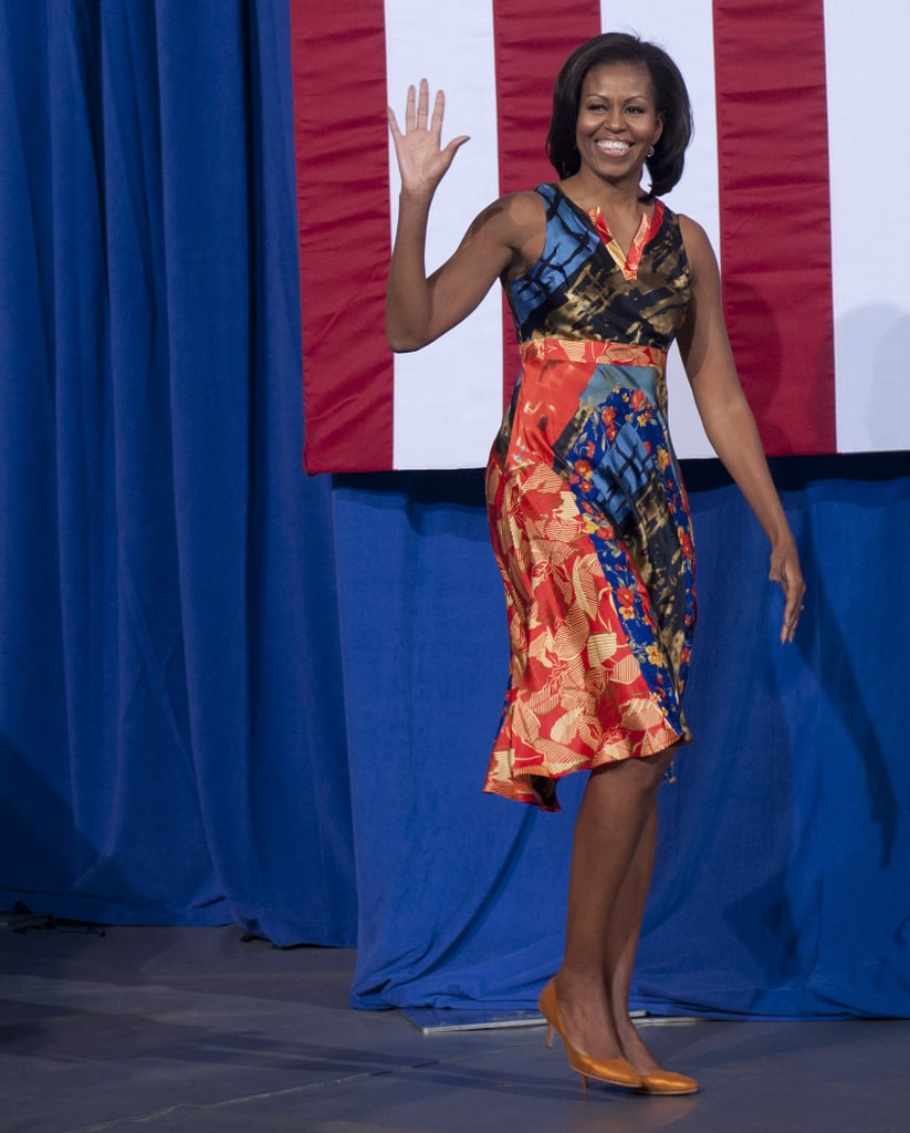 She debuted this boldly printed Duro Olowu dress at the University of Washington in Fredericksburg, VA. To finish off the look, she wore low-key tan pumps.