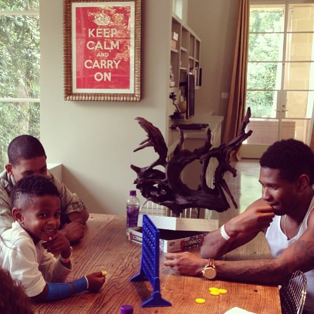 He shared a snap while playing a game of Connect Four with his son Usher Raymond V in August 2013. Source: Instagram user howuseeit