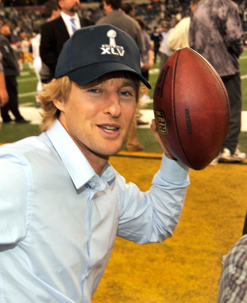 Owen Wilson posed with the pigskin on the sidelines in 2011.