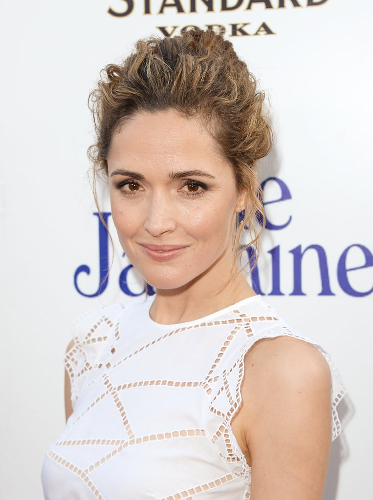 Looking sweet in a white dress, Rose Byrne pulled her heavily textured hair back into a bun with soft wisps around her face for a romantic feel.