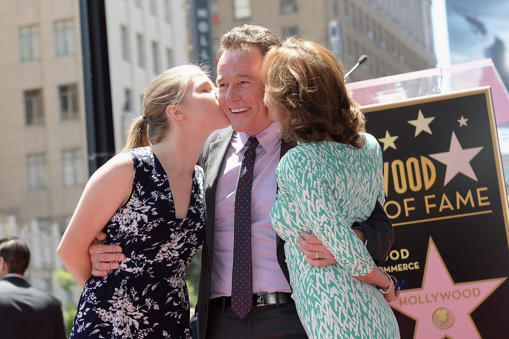 Bryan Cranston got a kiss from his wife, Robin Dearden, and daughter,  Taylor Dearden Cranston.