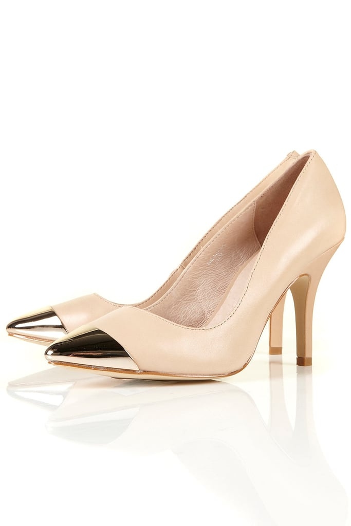 Add this on-trend pair to shake up the LBD you already have hanging in your closet.  Topshop Gabbi Metal Toecap Pumps ($100)