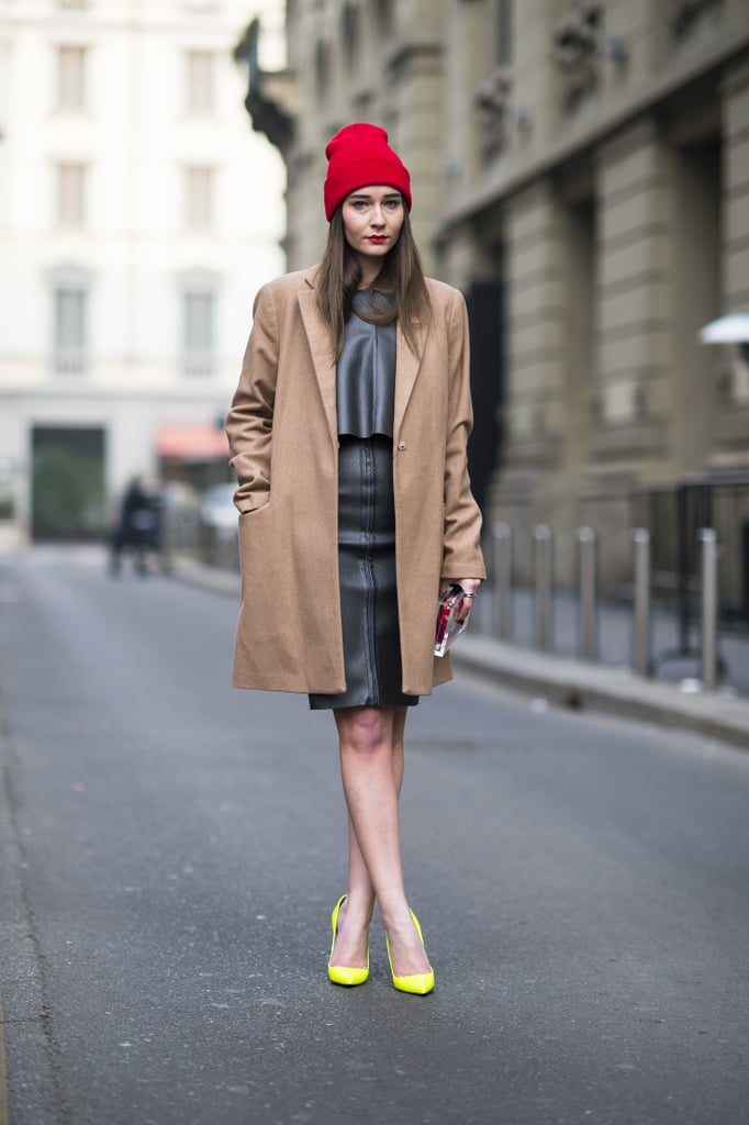 A bold red beanie and bright pumps amped up a classic camel coat and leather skirt. Source: Le 21ème | Adam Katz Sinding