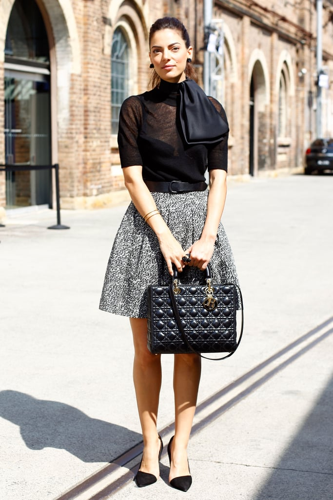 A flared tweed skirt was paired with a sheer bow blouse and pointy pumps for the ultimate ladylike statement.