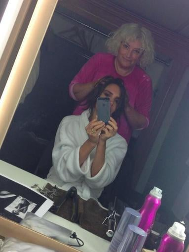 Victoria Beckham got her hair and makeup done before a photo shoot. Source: Twitter user victoriabeckham