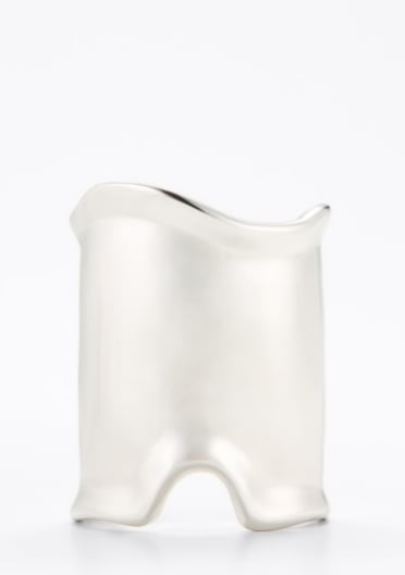 All you need is one statement piece to shine; this one is a sleek option.  Ann Taylor Sculptural Cuff ($68)