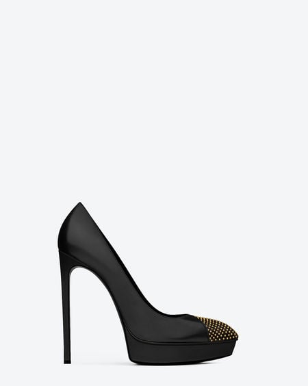 Side view of the Janis studded cap-toe pump in calfskin leather ($795).